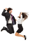We did it!. An handsome businessman and a gorgeous businesswoman jumping over a white background Stock Photos