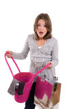 Did I buy that?. Teenage girl looking shocked at the content of her shopping bag Stock Photography