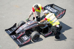 Did Not Finish. HOCKENHEIM, GERMANY - AUGUST 1, 2015: Not all cars managed to finish the endurance race of the Formula Student Design Competition: Two marshalls Royalty Free Stock Image