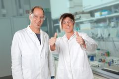 They did it right. Two chemists are really happy on the job Stock Image