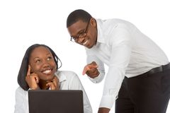 Did you do this?. Male points to laptop while female pretends that she has nothing to do with the content of the display Royalty Free Stock Image