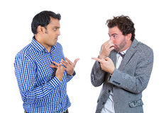 Did you do it?. Closeup portrait, men looking at guy closing, covering nose, something stinks, very bad smell, odor. Male asks me? Isolated white background Royalty Free Stock Image