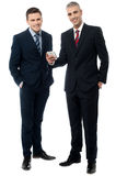 Did you see my new application. Happy businessmen browsing on mobile phone stock photos