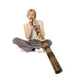 Didgeridoo di gioco del tirante Immagini Stock Libere da Diritti