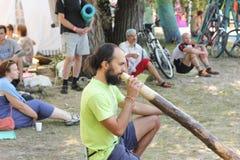 Didgeridoo massage Royalty Free Stock Photo