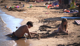 DIDIM, TURKEY - JULY 9, 2014. Child playing with toys on the sea Stock Photos