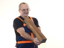 Die ältere Arbeitskraft mit dem Werkzeug Lizenzfreies Stockbild