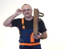 Die ältere Arbeitskraft mit dem Werkzeug Stockbild