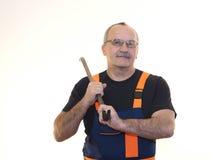 Die ältere Arbeitskraft mit dem Werkzeug Lizenzfreie Stockbilder