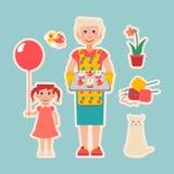 Die ältere vorbereitete Frau backt für ihre Enkelin zusammen Stock Abbildung
