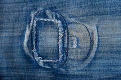 Die Änderung am Objektprogramm auf seinen Jeans. Stockfoto