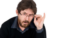 Die überraschten tragenden Gläser des Mannes Stockbild