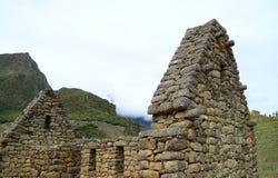 Die Überreste von altem Inca Architecture in archäologischer Fundstätte Machu Picchu, Cusco-Region, Peru stockbild
