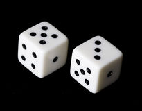 Die. In black background. Game object royalty free stock photos