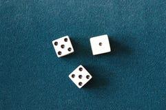Die. The die on green carpet royalty free stock image