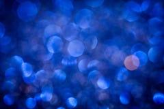 Die abstrakte Unschärfe blaue bokeh Beleuchtung von der Funkelnbeschaffenheit Lizenzfreie Stockfotos