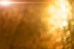 Die abstrakte Unschärfe goldene bokeh Beleuchtung Lizenzfreie Stockfotografie
