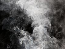 Die abstrakte Zahl des Rauches auf einem schwarzen Hintergrund Lizenzfreie Stockbilder