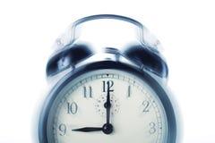 Die Alarmuhraufrufe Stockfoto