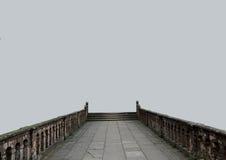 Die alte Brücke auf einem grauen Hintergrund Stockfotografie