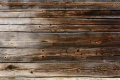 Die alte graue Wand der Bretter, die dunkle Beschaffenheit lizenzfreie stockbilder