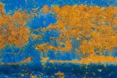 Die alte Metallbeschaffenheit mit der Schale der blauen Farbe und des Rosts Stockfotos