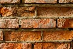 Die alte rote Backsteinmauer Stockfoto
