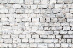 Die alten Steinwände Die Backsteinmauer des Hauses Grauer strukturierter Hintergrund Abstraktion Stockfotografie