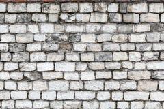 Die alten Steinwände Die Backsteinmauer des Hauses Grauer strukturierter Hintergrund Abstraktion Lizenzfreie Stockfotografie