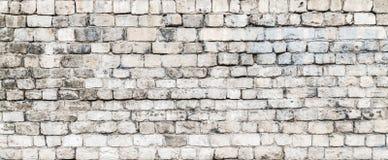Die alten Steinwände Die Backsteinmauer des Hauses Grauer strukturierter Hintergrund Abstraktion Stockfoto