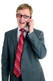 Die Arbeitskraft spricht durch Telefon lizenzfreie stockbilder