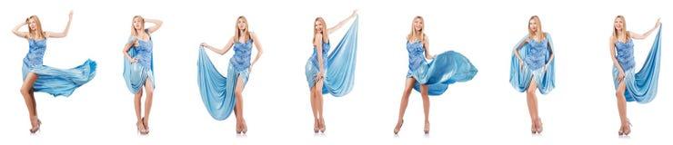 Die attraktive Frau im blauen Kleid auf Weiß Stockfotografie