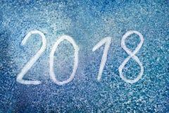 Die Aufschrift 2018 auf dem gefrorenen Glas Lizenzfreies Stockbild