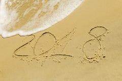 Die Aufschrift auf dem goldenen Sand 2018 Stockbild