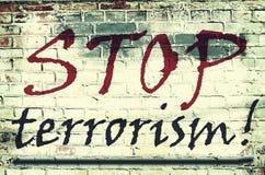 Die Aufschrift auf der Wand mit dem Slogan Stockfotografie