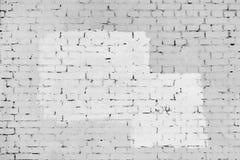 Die Backsteinmauer wird mit weißer und grauer Farbe gemalt Hintergrund mit Rahmen und Platz für Text, Beschaffenheit Stockfoto
