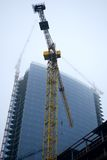Die Bauindustrie in einem Nebel Lizenzfreies Stockbild