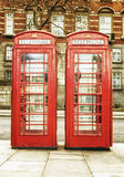 Die berühmten roten Telefonkabinen in London Lizenzfreies Stockbild