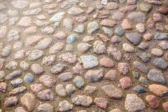 Die Beschaffenheit der alten Granitpflasterung stockfotos