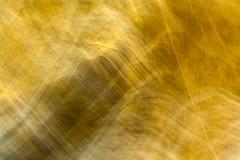 Die Beschaffenheit der Goldfarbe für Hintergrund Lizenzfreie Stockbilder