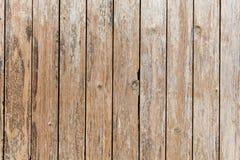 Die Beschaffenheit der hölzernen Planken, auf denen die Farbe mit Alter geknackt wird Lizenzfreie Stockfotografie