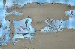 Die Beschaffenheit der Wand, umfasst mit grauen Schaumpolystyrenplatten, umfasst mit einer blauen Verstärkungsmasche und mit eine Stockfotografie