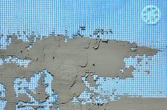 Die Beschaffenheit der Wand, umfasst mit grauen Schaumpolystyrenplatten, umfasst mit einer blauen Verstärkungsmasche und mit eine Stockfotos