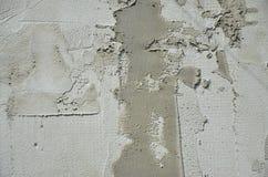 Die Beschaffenheit der Wand, umfasst mit grauen Schaumpolystyrenplatten, die mit einer Verstärkungsmischung geschmiert werden Sta Stockbilder