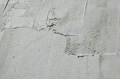 Die Beschaffenheit der Wand, umfasst mit grauen Schaumpolystyrenplatten, die mit einer Verstärkungsmischung geschmiert werden Sta Stockfotos