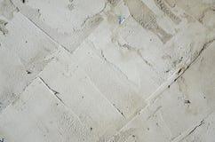 Die Beschaffenheit der Wand, umfasst mit grauen Schaumpolystyrenplatten, die mit einer Verstärkungsmischung geschmiert werden Sta Lizenzfreie Stockbilder