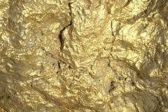 Die Beschaffenheit des Hintergrundes der Goldgeldstangen stockfoto