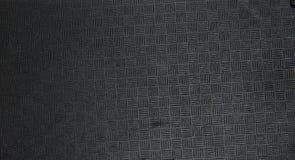 Die Beschaffenheit des schwarzen Plastiks mit notchesn Lizenzfreies Stockfoto