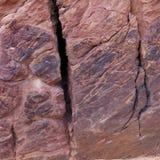 Die Beschaffenheit, die durch Abnutzung gemacht werden und die Oxidation verzieren diese Sandsteinwand in der Wüste von Süd-Utah stockfotografie