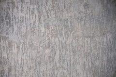 Die Beschaffenheit einer grauen Betonmauer mit flacher Beschaffenheit Lizenzfreie Stockfotografie